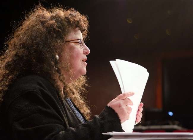 Playwright Sherry Kramer holding a script